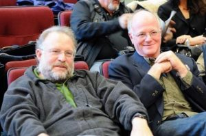 Ben Cohen and Jerry Greenfield, of Ben and Jerry's ice cream fame, casually dressed in the audience of a theatre