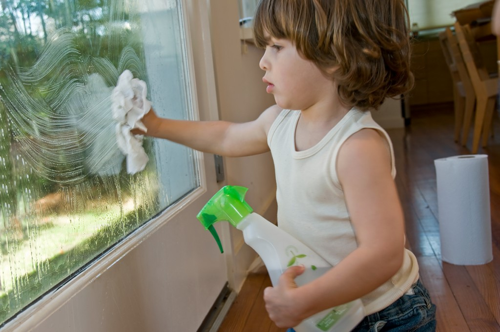 """Is he cleaning a solid or a liquid? Contrary to some claims, glass is a solid, not a very thick liquid. Source: """"Cleaning Window"""" by newlivinghouston is licensed under Creative Commons Attribution 2.0 Generic"""