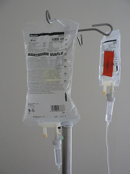 """Medical personnel commonly must perform dilutions for IV solutions. Source: """"Infuuszakjes"""" by Harmid is in the public domain."""