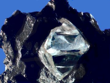 """Diamond is the hardest known natural substance and is composed solely of the ele- ment carbon. Source: """"Rough Diamond"""" by United States Geological Surveyis in the public domain"""