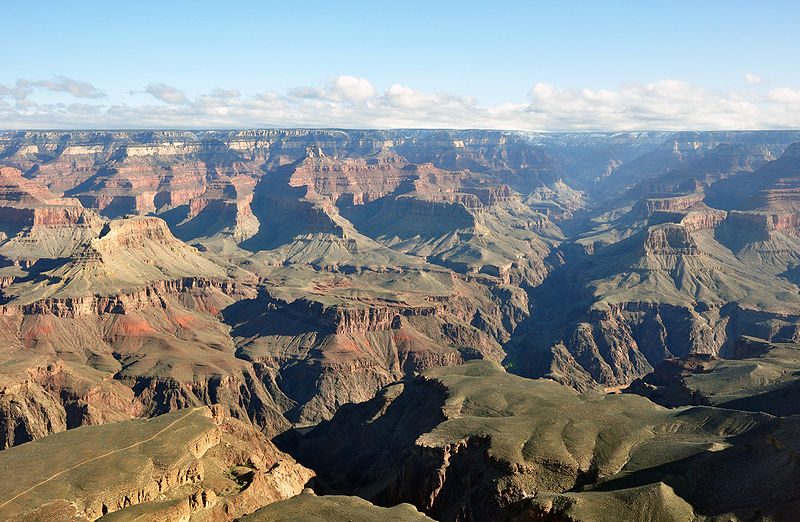 """The Grand Canyon was formed by water running through rock for billions of years, very slowly dissolving it. Note the Colorado River is still present in the lower part of the photo. """"Grand canyon yavapal point 2010′′ by chensiyuan is licensed under Creative Commons"""