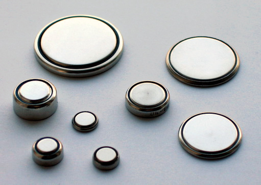 """Button batteries like those seen here can be used for a variety of portable electronics, from watches and hearing aids to handheld gaming devices. Source: """"Coin Cells"""" by Gerhard H Wrodnigg is licensed under the Creative Commons Attribution-Share Alike 2.5 Generic license."""