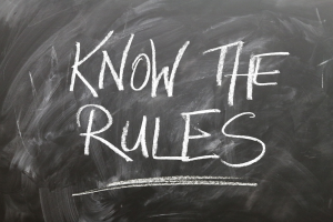 """Writing on a blackboard that reads, """"Know the rules"""""""